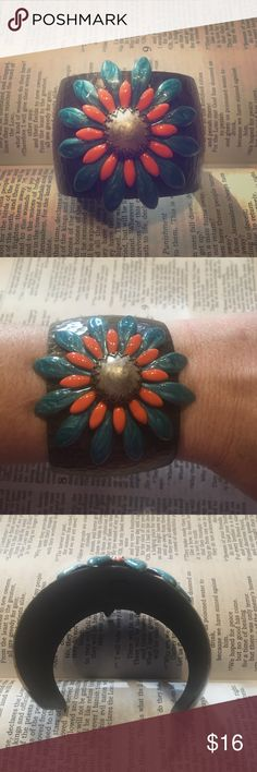 "Antique gold cuff bracelet with flower medallion 🔹ALL ITEMS ARE BOGO 50% OFF OF EQUAL OR LESSER VALUE ITEM OR BUY 3+ JEWELRY ITEMS FOR $5/PIECE🔹2"" width, adjustable. Flower is made of turquoise and orange enamel petals.  The flower center is an antique silver cabachon bead. Ollipop Jewelry Bracelets"