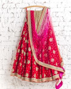 lehengas by SwatiManish : Kumkum red Lehenga with shocking pink and red dupatta