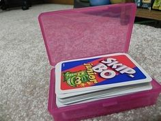 Use dollar store soap boxes to organize card games. Keep them dry on a camping trip too.