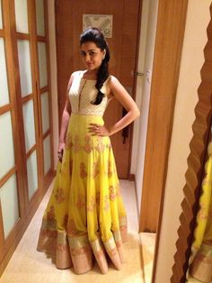 Sisters Kajal Aggarwal and Nisha Aggarwal wearing SVA by Sonam and Paras Modi to the CineMaa Awards in Hyderabad.hair style simran find this yellow anarkaliperfect anarkali for a sangeetOmg a dress and lengha combo Floor Length Anarkali Desig Indian Gowns, Indian Attire, Indian Ethnic Wear, Indian Outfits, Ethnic Fashion, Asian Fashion, Long Gown Dress, Long Dresses, Anarkali Dress