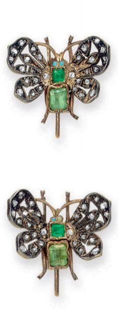 *A PAIR OF ANTIQUE EMERALD AND DIAMOND EAR CLIPS Each designed as a butterfly, the body set with two rectangular-cut emeralds, extending openwork rose-cut diamond wings, mounted in silver and gold, late nineteenth century