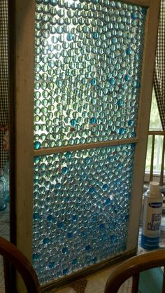 Glass Pebbles from the Dollar Store create this stain glass window look. I want to do this in my bathroom to create some privacy,