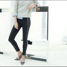 J. Crew Pixie Pants w/ Exposed Gold Zipper Pockets Like a legging but more structured, it's made from a stretchy holds-you-in fabric and looks good on everyone. Side panels create an even leaner silhouette while golden hardware adds some edge.  All stock photos of the pants courtesy of J. Crew website or blogs.  Last pic is of actual pants that I have. Kind of dark so please refer to stock photos for the details. They are dark navy with black paneling. See top left & bottom right as a…