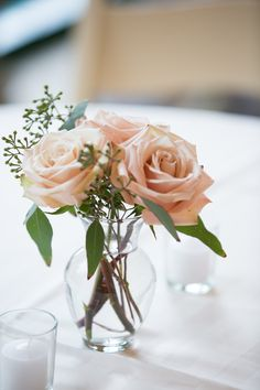TABLECLOTH OPTION 2: white floor length tablecloths with blush colored flowers