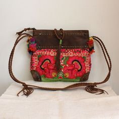 One-of-a-kind Purse made from Guatemalan textiles and brown leather with colorful hand-stitched detail.