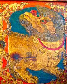 15 th. century Tibet alter piece depicting snow Lion peeking from under a Throne. Snow lions are celestial animals in Tibet, representing unconditional Happiness.