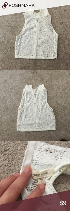 Lace high neck crop top It is a sheer crop top with white lace. Only worn once. The back is zip up and it is a medium but runs sort of small. Tops Crop Tops