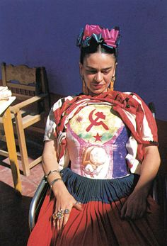 Frida Kahlo: Fashion as the Art of Being. Wearing one of her plaster corsets, which she decorated with the Communist hammer and sickle, c. 1951–52.