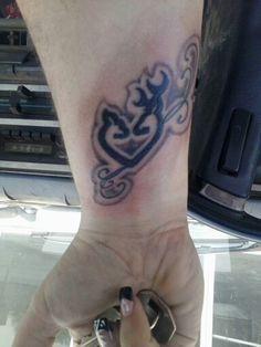 Browning tattoos on wrist