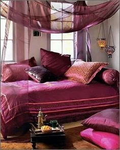 Moroccan Bedroom Design With White Purple Bedroom Wall Pillow Bed Blanket Curtain Nightstand And Brown Carpet Chandelier Window Morrocan Decor, Moroccan Room, Moroccan Interiors, Moroccan Bathroom, Moroccan Bedroom Decor, Moroccan Bedding, Modern Moroccan, Moroccan Design, Moroccan Colors