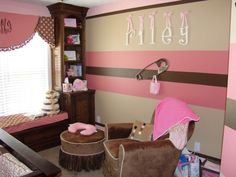 See Brandi!!  There's the name in the nursery, not a fan of the way it's painted, but I think the room will be dark brown with a light pink accent wall, white wainscoat.