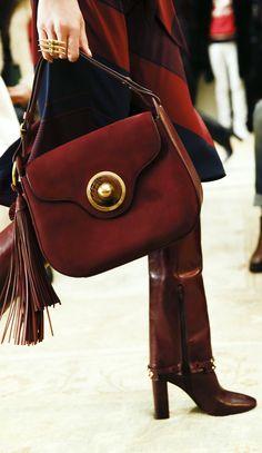 A closer look: a tasseled shoulder bag in a rich shade of burgundy