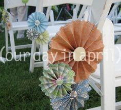 love this chair decor idea - using coordinating scrapbook papers matching the wedding colors would be fun - could also do a hand crafted flower for the center
