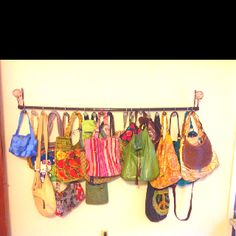 Curtain pullbacks, spray painted shower rod and shower hooks= instant purse rack!