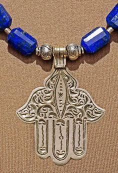 A vintage handmade Hamsa or Khamsa from Morocco in quality Silver . Fantastic VERY high quality, deep blue faceted Lapis Lazuli from Hamsa Jewelry, Tribal Jewelry, Turquoise Jewelry, Ancient Protection Symbols, Hamsa Drawing, Lapis Lazuli Jewelry, Map Tattoos, Hand Of Fatima, Hamsa Hand