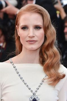 Jessica Chastain matches her flame-haired tresses to her soft apricot lip.