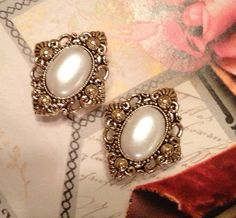 Hey, I found this really awesome Etsy listing at https://www.etsy.com/listing/127090467/vintage-pearl-gold-plugs-guages-double