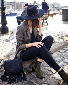 Black fedora, checked black and white blazer and army green Chelsea boots