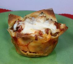 """These Lasagna Wonton """"Cupcakes"""" are bursting with meaty, cheesy, saucy flavor. Just  165 calories or 4 Weight Watchers points each! www.emilybites.com #healthy"""