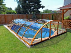 Another pool enclosure UNIVERSE using beautiful and luxury wood-like imitation color. Swimming Pool Enclosures, Patio Enclosures, Swimming Pools, Small Spa, Small Backyard Pools, Garden Bridge, Covered Pool, Outdoor Gear, Outdoor Structures