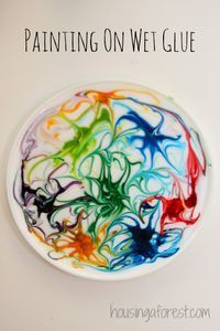 Painting on wet glue with food colouring. Once the glue has completely dried then peel it off, punch a hole in the top and hang with a string in a window...the result is a beautiful sun catcher!