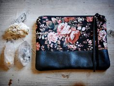 floral fabric and black leather zipper pouch $30 from hoakonhelga on Etsy