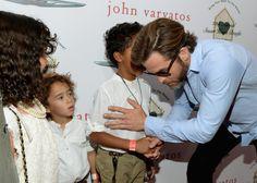 Awww, so cute.  Chris with Ziggy Marley's kids