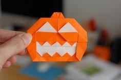 Origami jack-o-lantern Halloween pumpkin - How About Orange Origami Garland, Origami Diy, Origami Paper Art, Origami Tutorial, Oragami, Halloween Ideas Para Decorar, Halloween Crafts, Halloween Decorations, Halloween Party