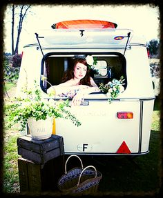 Vintage 'Puck' Caravan, used as a photobooth for a rustic wedding shoot at The Keeper and the Dell - Unique Norfolk Outdoor Wedding Venue