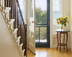 Entrance foyer of traditional home - Lived In Images/The Image Bank/Getty Images