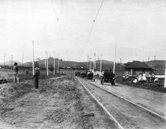The parade approaches Sunset Boulevard on what was then named Lake Short Avenue. Today, this stretch of Lake Shore is Glendale Boulevard, and the Angelus Temple stands on the right side of this photograph. Courtesy of the USC Libraries - California Historical Society Collection.
