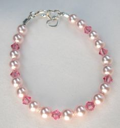 Items similar to Pink Swarovski Pearls and Pink Crystals Bracelet (BPPPC) on Etsy Little Girl Jewelry, Kids Jewelry, Jewelry Crafts, Jewelry Making, Crystal Bracelets, Jewelry Bracelets, Silver Bracelets, Jewellery, Cristal Rose