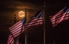Last night's full moon -- also called a strawberry moon in June -- rises from behind a group of American flags at the Washington Monument at National Mall and Memorial Parks in Washington, D.C. This rare sight is the first full moon to fall on the summer solstice in more than 50 years. . Photo courtesy of Andrew Geraci. — at National Mall and Memo