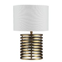 """The wide slats of the base with the empty space in between help this table lamp stand out. The """"hard"""" solid cylindrical base of this table lamp also blend..."""