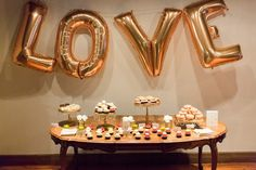 Featured photographer: Koman Photography; wedding reception dessert table idea