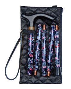 A glamorous folding cane with an elegant black quilted bag The pattern features small pink and blue flowers on a purplish-black background Folds to