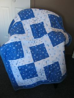 blue and white flannel  snowflake tied quilt