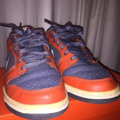 Nike dunk low Nike dunk low with three colors: orange, grey and white. Shoes been worn a handful of times, and the white has turned yellow. However, it is still in great condition. Comes with shoe box. Boys size 5, Women size 7! Nike Shoes