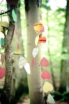 recycled paper heart garlands in the trees... so light and magical