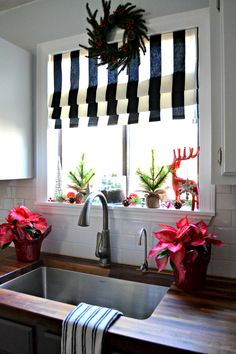 Step By Step Process Of How To Create A Christmas Kitchen Window Vignette  (featuring A Black And White Faux Roman Shade DIY Project).