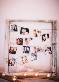 Cute photo display. Would be cute for couples to have over their bed with accent frames or sleek looking shelving on each side
