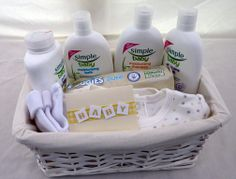 BUDGET NEW BORN BABY GIFT BASKET (with Simple Baby products) £19.95 plus £7.50 carriage to mainland UK (Ex Scottish Highlands)   This beautifully presented New Born Baby Gift Basket is our entry level gift basket, but despite its low cost it is still full of useful everyday essentials for when the proud parents first bring their pride and joy home.  (It is available in girl's, boy's or NEW Neutral option and also with Johnson's Baby products)