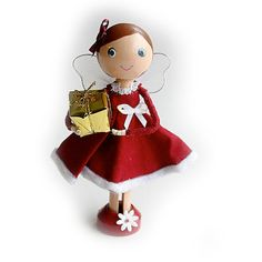 SALE Christmas Fairy/Angel Clothespin Doll with Christmas by Troodlecraft She is dressed in a pretty red and white dress, with a white bow and a red bow in her hair. She is holding a gold wrapped Christmas present