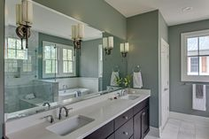 Master Bathroom - Pewter Sconces with Ivory Silk Shades | by Marcelle Guilbeau #masterbath #bluegreen #whitemarble #whitewainscot #beadboard #pewter #sconces