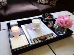 how to style your coffee table with five key pieces. Tray, coffee table book, candle, vase, interesting container
