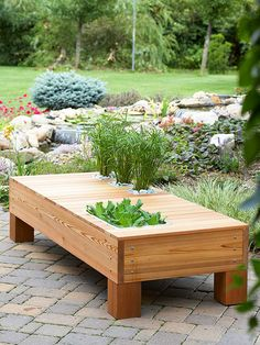 Multitasking Outdoor Table Multitask with a cedar bench that transforms from rock and water garden to savvy serving table.