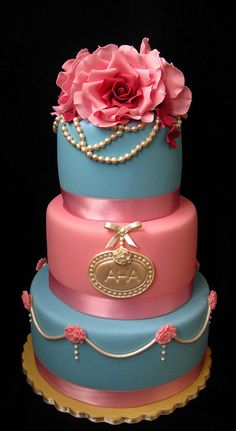 Bottom two tiers only, pearls draping the top tier.  Gold glitter one as a topper.  Monogram glittery too.