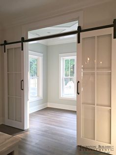 A crisp alternative to barn doors. I'm liking this look ❤️ A crisp alternative to barn doors. I'm liking this look ❤️ - Door House Design, House, Home, Home Remodeling, House Plans, New Homes, Home Renovation, Glass Barn Doors, Doors