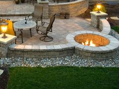 Patio with benches and firepit built in. A's dream.