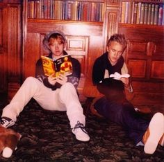 Rupert Grint (Ron Weasley) and Tom Felton (Draco Malfoy) on the set of Harry Potter.